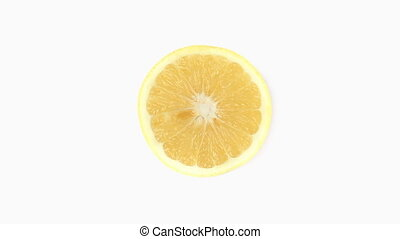 Half a lemon rotating on a white background