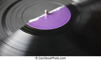 half a record on turntable - an old record broken in half on...