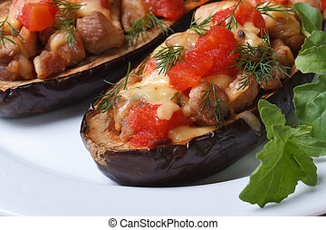 half baked aubergine with meat, cheese and tomatoes