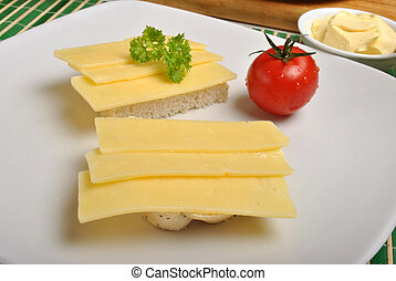 half bread roll with cheese on a plate