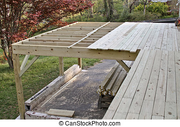 Half Built Deck - An exterior wooden deck half built in...