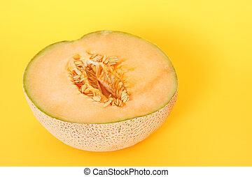 Half cantaloupe - A cantaloupe cut in half