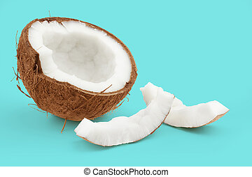 half coconut and pieces on blue background