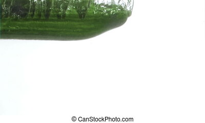 Half cucumber in a super slow motion falling in water...