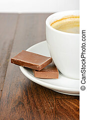 Half cup of coffee with chocolate on table
