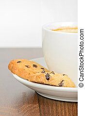 Half cup of coffee with cookies on table