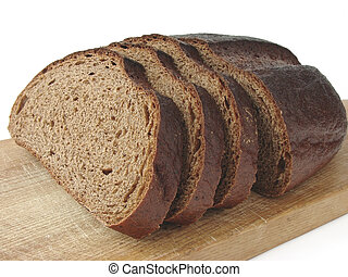 rye bread - half cut loaf of rye bread on kitchen board...