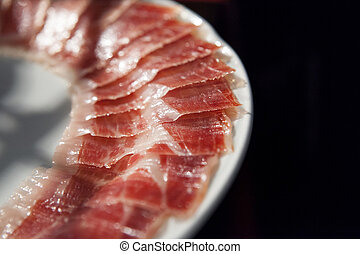 decorated arrangement of iberian cured ham on plate