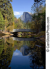 Half Dome behindSentinel Bridge - Fall view of Merced River,...