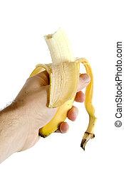 Half Eaten Banana - A half eaten banana being held in a...