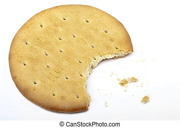 Half Eaten Biscuit - Half-eaten biscuit over a white...