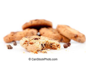Half-eaten cookie in front of a stack of cookies
