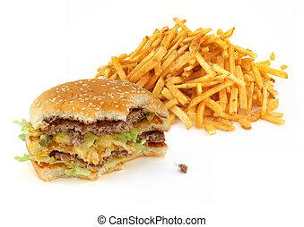 half-eaten hamburger and french fries against white...