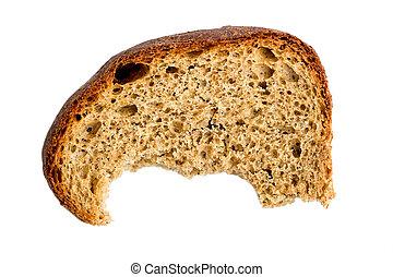 Half-eaten piece of dry rye bread