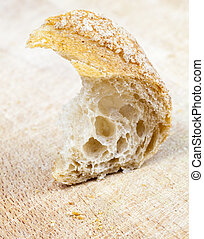 half eaten piece - half-eaten piece of light baguette from...