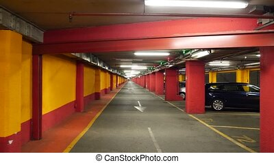 Half empty underground garage or parking. Cameraman walking...