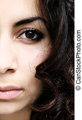 Half face abstract of a beautiful middle eastern girl