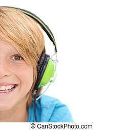 half face of smiling happy boy listening to music