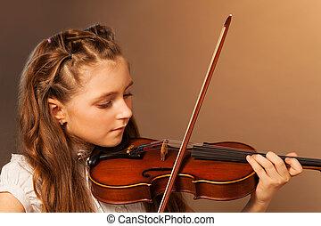 Half-face view of beautiful girl playing violin