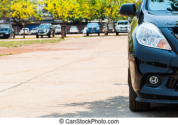 Half front view of black car park on the car park background