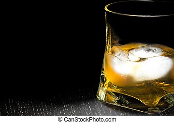 half glass of drink with ice
