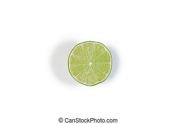 Half green lemon on a white background