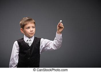 Half-length portrait of boy writing, on grey background....