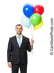 Half-length portrait of business man with balloons