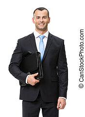Half-length portrait of businessman keeping case