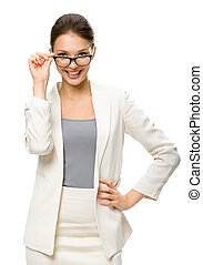 Half-length portrait of businesswoman wearing glasses, isolated on white. Concept of leadership and success