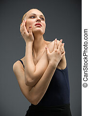 Half-length portrait of dancing ballerina, isolated on grey....