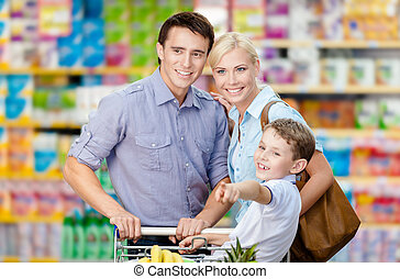 Half-length portrait of family in the shop. Concept of...