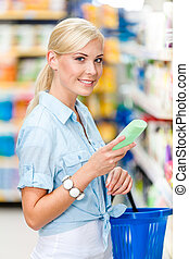 Half length portrait of girl at the store choosing cosmetics