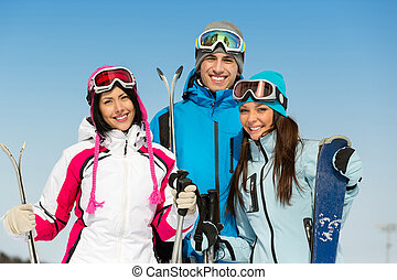 Half-length portrait of group of skier friends