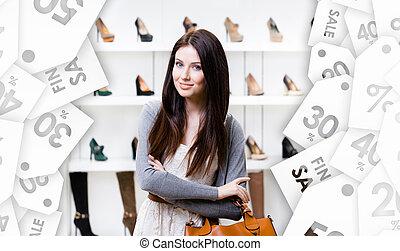 Half-length portrait of lady in shopping center. Seasonal sale