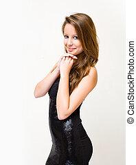Half length portrait of slender brunette woman.