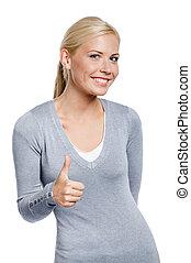 Half-length portrait of thumbing up woman