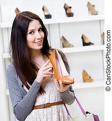 Half-length portrait of woman handing pump