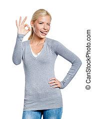 Half-length portrait of woman okay gesturing