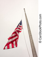 Half mast American flag concept as a symbol of the United States