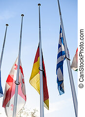 Half-mast flags of all the European Union countries after...