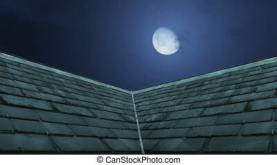 Half moon above old scary mansion - Big crescent above old...
