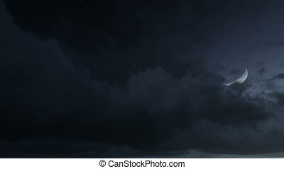 Half moon rising through the clouds - Night sky with half...