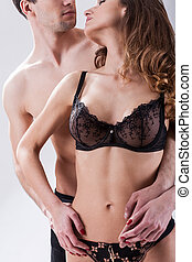 Half-naked flirting couple - Vertical view of half-naked...