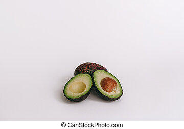 half of avocado on white background. top view
