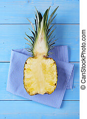 Half of pineapple on wooden table
