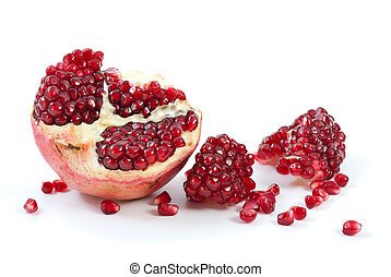 Half of pomegranate, piece and some berries isolated on the white background
