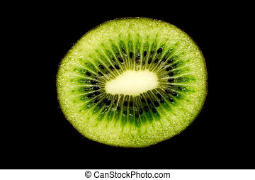 Half of the kiwi fruit slice closeup isolated on black background