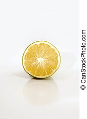 Half orange isolated over white