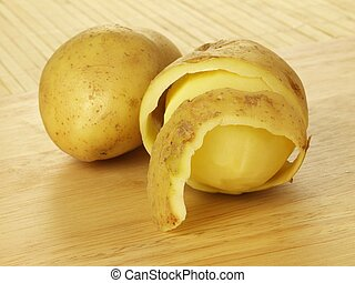 Half peeled potatoes